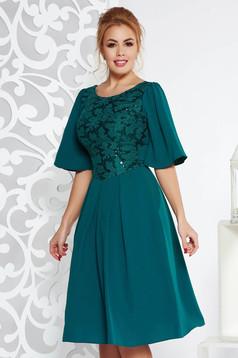 Sötétzöld alkalmi harang ruha enyhén elasztikus szövet belső béléssel flitteres díszítéssel